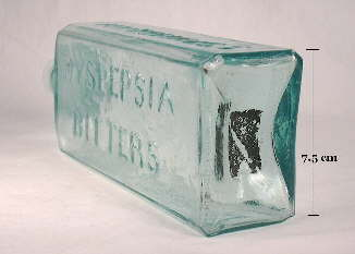 Rectangular iron pontil mark on the base of an 1850's bitters bottle from New York; click to enlarge.
