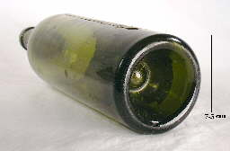 Close-up view of the push-up base of circa 1900 turn mold bottle; click to enlarge.