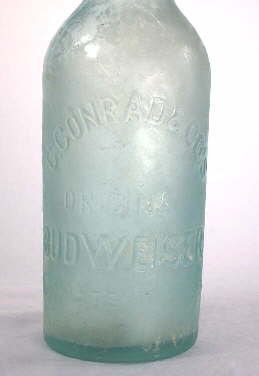 Milky stain on an 1880 beer bottle; click to enlarge.