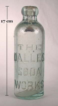 Hutchinson soda bottle with heavy embossing; click to enlarge.