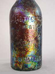 Early 20th century beer bottle with colorful patination; click to enlarge.