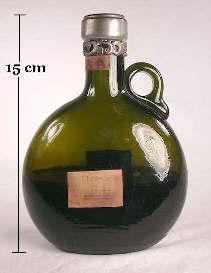 Applied handle liquour bottle from the late 19th century; click to enlarge.
