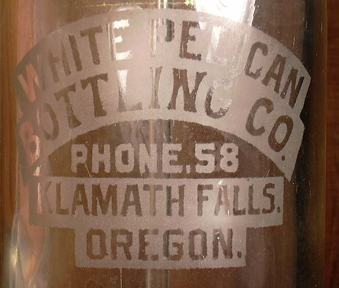Hyperlink to a closeup picture of the etched lettering on a siphon bottle.
