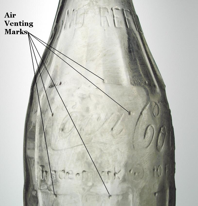 Hyperlink to a machine-made bottle exhibiting venting marks.