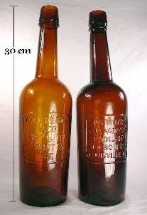 Pair of plate molded Western whiskey bottles; click to enlarge.