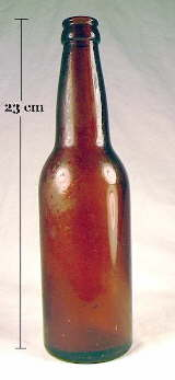 Early machine-made beer bottle in medium amber color; click to enlarge.