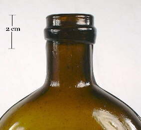 Image of a champagne style finish on a mid 19th century pictorial liquor flask; click to enlarge.