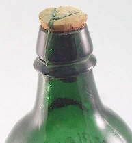 Wired down cork on miineral water bottle; click to enlarge.