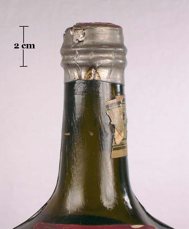 Hyperlink to a picture of a capsule on an early 20th century medicinal tonic bottle.