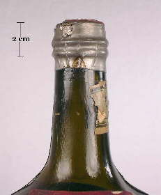 Foil seal over a cork on a Ferro-China medicinal tonic bottle; click to enlarge.