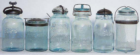 Group of fruit jars with different closures.