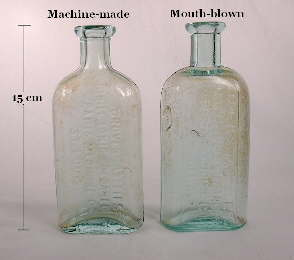 A pair of Groves Chill Tonic bottles with different manufacturing histories; click to enlarge.