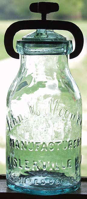 Hyperlink to a picture of a John Moore jar with thumbscrew & lid closure.