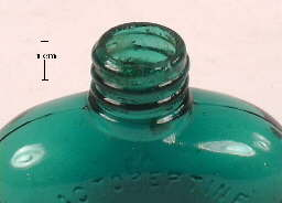 Image of an early 20th century medicine bottle with a ground external screw thread finish; click to enlarge.