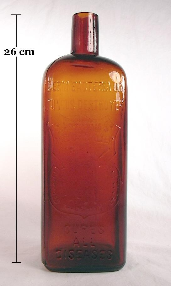 Hyperlink to an image of a large early 20th century medicinal bottle with a straight finish.