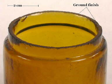 Image of a late 19th century ointment jar with a ground finish; click to enlarge.