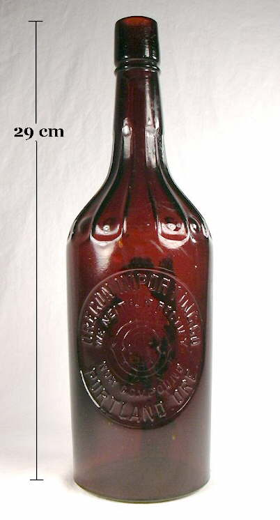 Hyperlink to an image of a early 20th century cylinder liquor bottle.