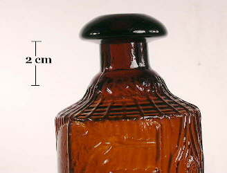 Image of a late 19th Tippecanoe bottle with it's unique finish; click to enlarge.