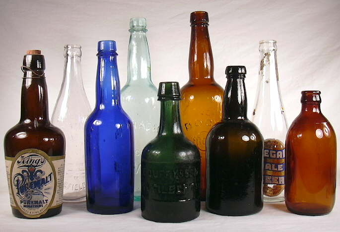 Beer bottles dating from 1860 to 1930; click to enlarge.