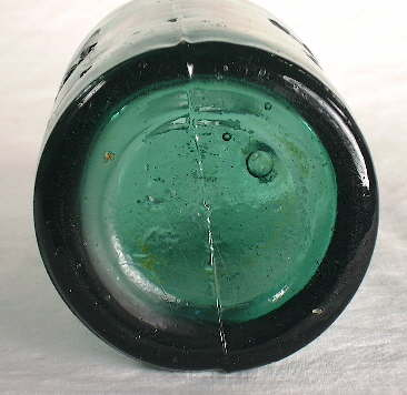 Two-piece mold base on an 1860s stout bottle; click to enlarge.