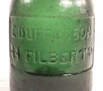 Close-up image of a plate on a mid-1850s porter bottle; click to enlarge.