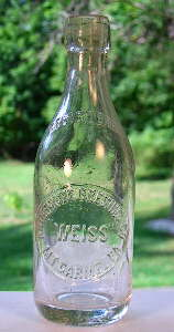 Early 20th century weiss beer bottle; click to enlarge.