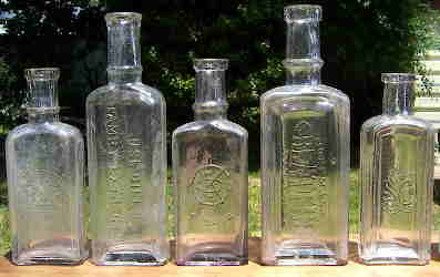 Group of late 19th century extract bottles; click to enlarge.