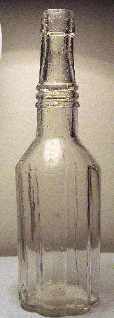 Late 19th century fluted pepper sauce bottle; click to enlarge.