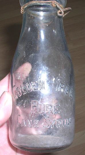 Hyperlink to a reverse view of this milk bottle used for syrup.