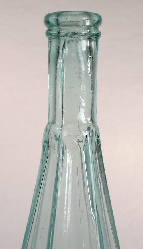 Hyperlink to an image of this bottles shoulder, neck and finish.