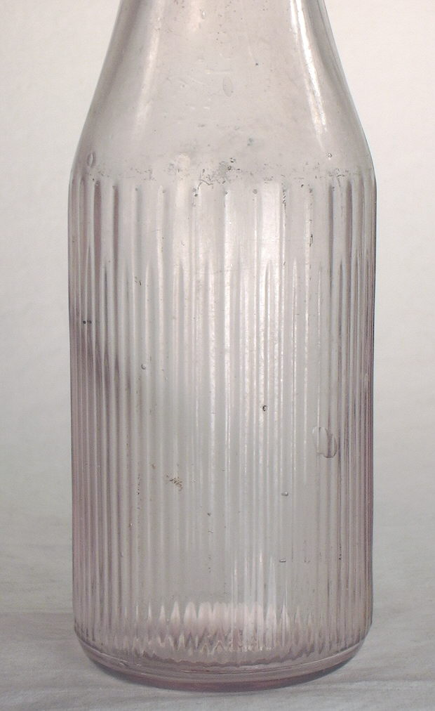 Hyperlink to an image of this bottles reverse side.