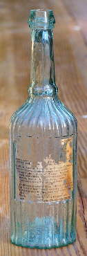 Mid-19th century sauce bottle used for medicine; click to enlarge.