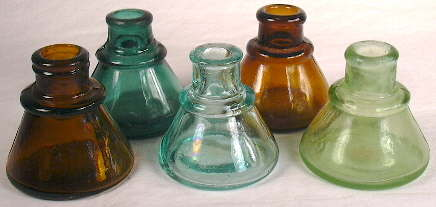 Group of mouth-blown cone ink bottles from about 1900.