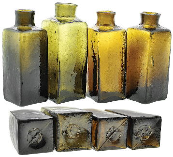 Four early American blacking bottles - ca 1820s-1840s