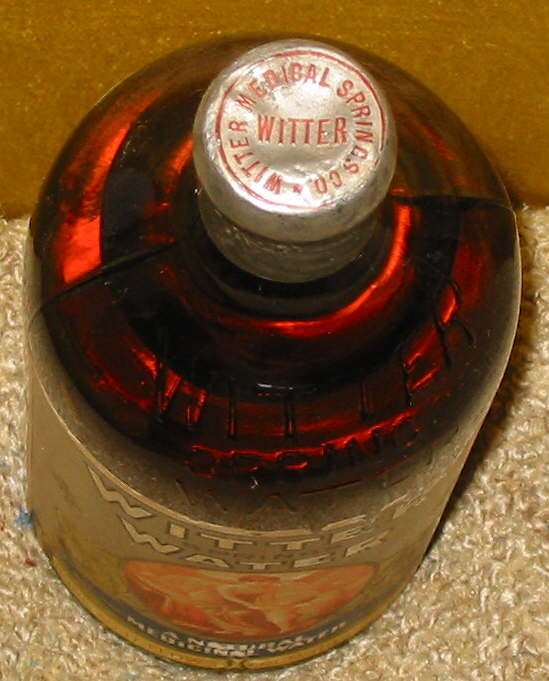 Hyperlink to a top view image of this bottles foil seal.