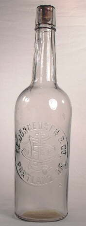 Early 20th century mouth-blown liquor bottle; click to enlarge.