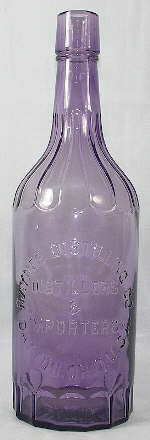 Early 20th century liquor bottle with fluted shoulders; click to enlarge.
