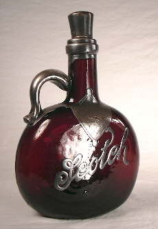 Late 19th century handled scotch decanter.