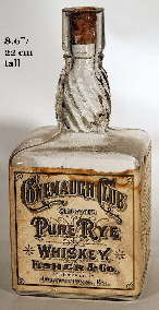 Early 20th century square liquor with swirled neck; click to enlarge.