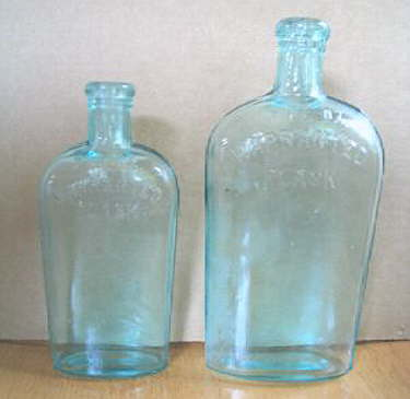 Hyperlink to an image of two different size Warranted Flasks.