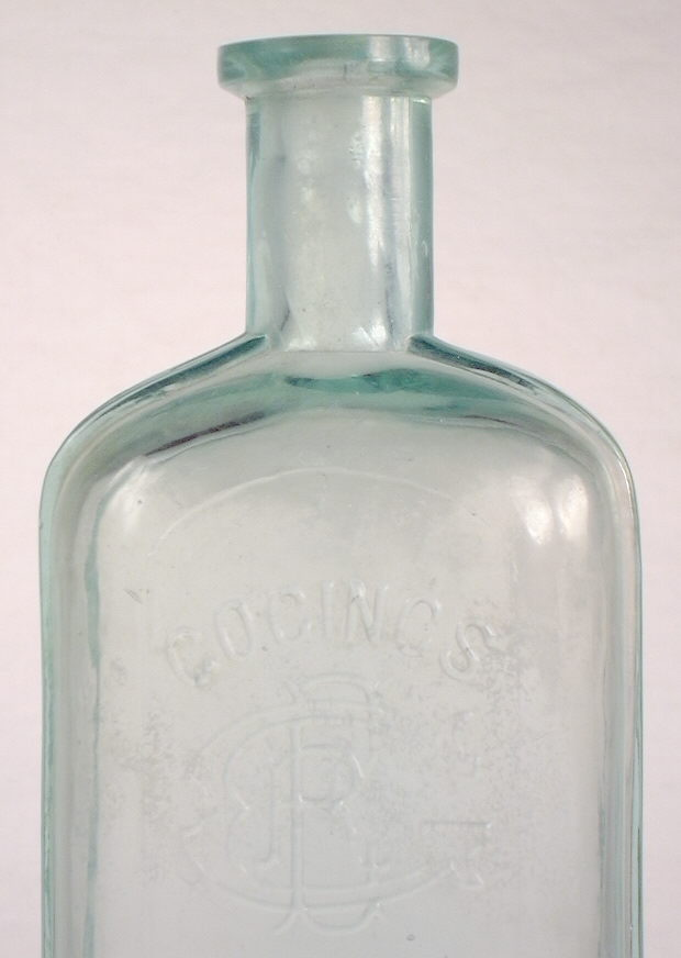 Hyperlink to a close-up view of this bottles shoulder, neck, and finish.