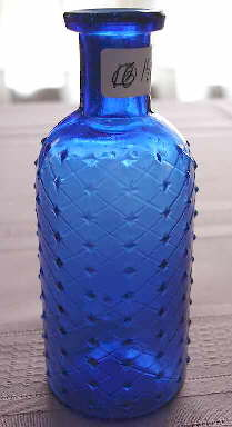 Lattice embossed poison bottle; click to enlarge.