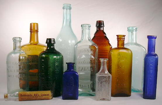 Grouping of medicinal bottles dating from the 1860s to 1920s; click to enlarge.