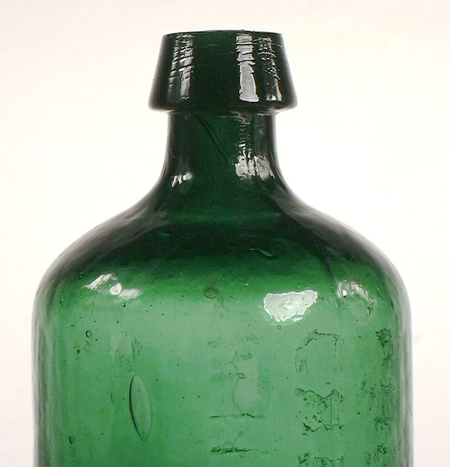 Hyperlink to a close-up of this bottles shoulder, neck, and finish.