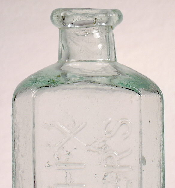 Hyperlink to a close-up image of this bottles shoulder, neck, and finish.