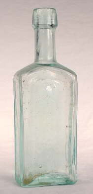 Mid-19th century paneled medicinal bottle; click to enlarge.