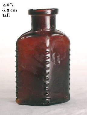 Early 20th century poison mouth-blown poison bottle; click to enlarge.