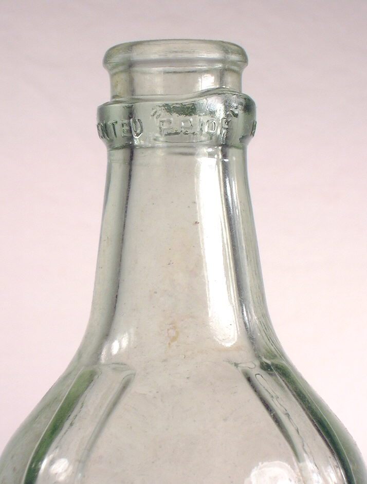 Hyperlink to an close-up image of this bottles shoulder, neck, and finish.