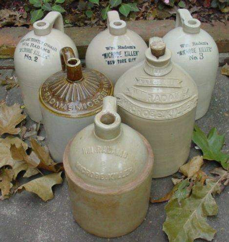 Late 19th to early 20th century pottery Microbe Killer jugs.