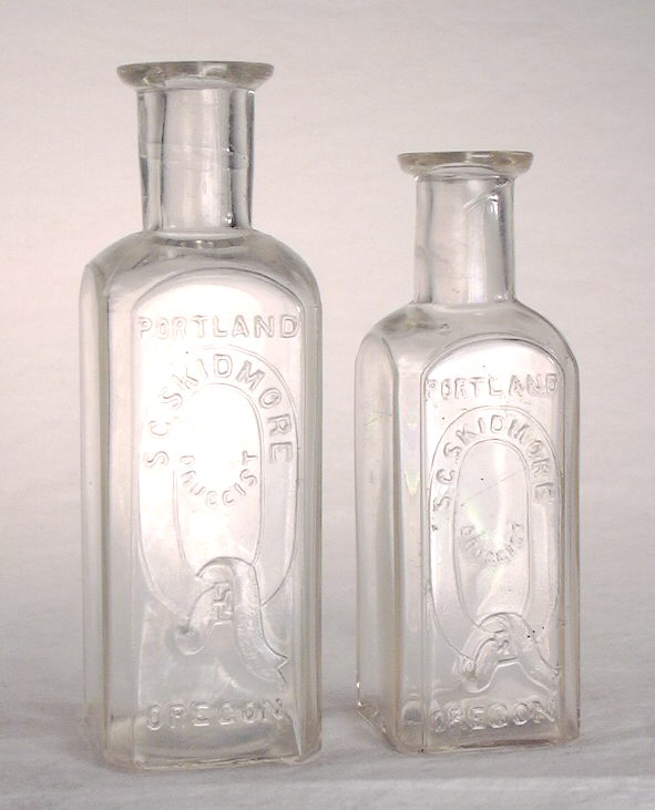 Hyperlink to an image of two Skidmore druggist bottles.